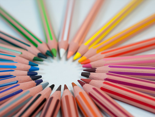 Photo of colors pencils arranged in a circle