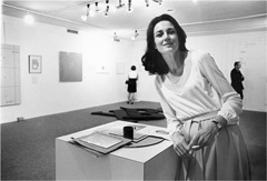 Caption: Virginia Dwan standing in the Language III installation (May 24–June 18, 1969). Photo courtesy Dwan Archive