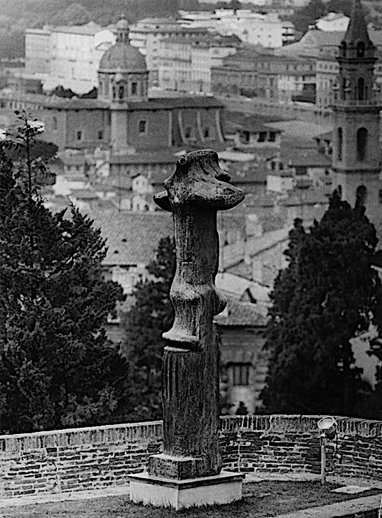 "Black-and-white photograph of a Henry Moore sculpture, ""Upright Motive No. 1: Glenkiln Cross,"" in the Forte di Belvedere, Florence"