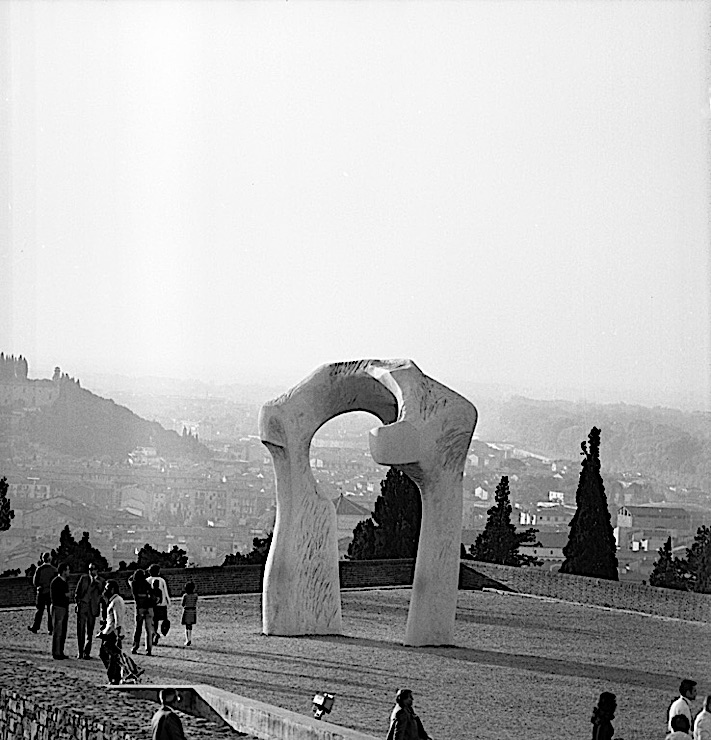"Black-and-white photograph of a Henry Moore sculpture, ""The Arch,"" in the Forte di Belvedere, Florence"