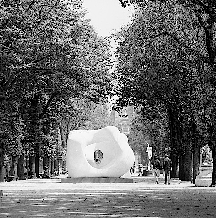 "Black-and-white photograph of a Henry Moore sculpture, ""Large Two Forms,"" in the Jardin des Tuileries, Paris"