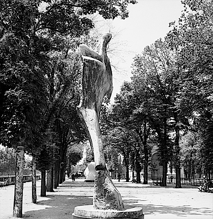 "Black-and-white photograph of a Henry Moore sculpture, ""Standing Figure: Knife Edge,"" in the Jardin des Tuileries, Paris"