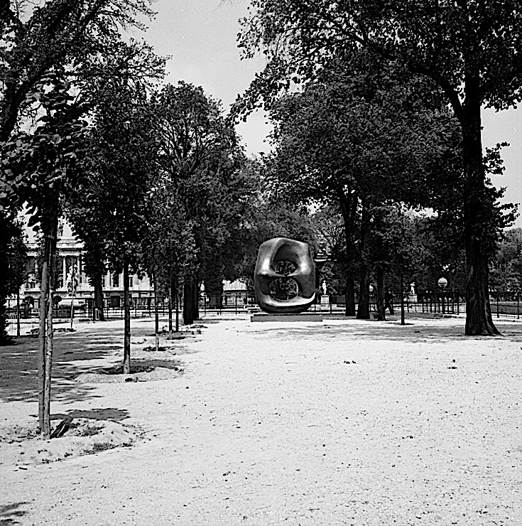 "Black-and-white photograph of a Henry Moore sculpture, ""Oval with Points,"" in the Jardin des Tuileries, Paris"