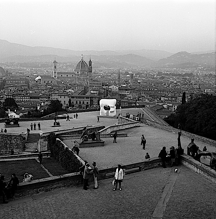 "Black-and-white photograph of a Henry Moore sculpture, ""Large Square Form with Cut,"" in the Forte di Belvedere, Florence"