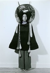 Senga Nengudi, in performance with Inside / Outside, 1977