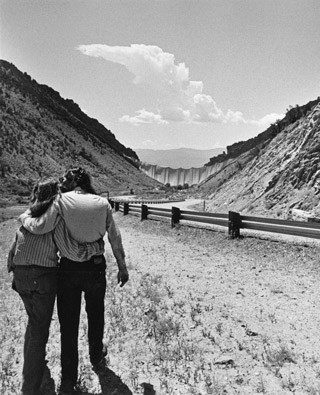 Christo and Jeanne-Claude with the finished project 'Valley Curtain, Rifle, Colorado', 1970-72, August 10, 1972, gelatin silver print, Shunk-Kender Photography Collection, Department of Image Collections, National Gallery of Art Library, Gift of the Roy Lichtenstein Foundation in memory of Harry Shunk and János Kender. © Christo. Photograph: Shunk-Kender © J. Paul Getty Trust. All Rights Reserved.