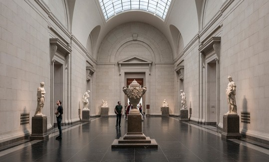 The East Sculpture Hall of the West Building at the National Gallery of Art, Washington—a stately passageway between the Rotunda and the East Garden Court—lined with marble works by some of the greatest French sculptors of the 17th to 19th centuries.