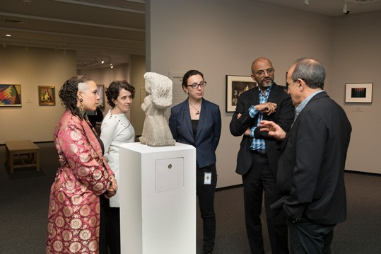 "CASVA members Rachel Grace Newman, Annie G. Miller, Megan Driscoll, and Steven Nelson with Harry Cooper, Curator and Head of Modern and Contemporary Art, discussing William Edmondson's ""Schoolteacher"" (1935, limestone, National Gallery of Art, Washington, Corcoran Collection [Gift of David and Renee McKee], 2015.19.3920)."