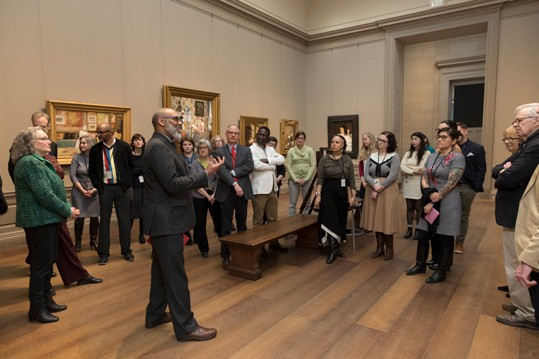 Richard J. Powell, Edmond J. Safra Visiting Professor, leads a tour in the American galleries to CASVA members.