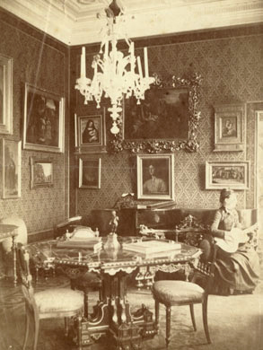 Louise M. Richter playing guitar in the Jean Paul Richter home, 1887